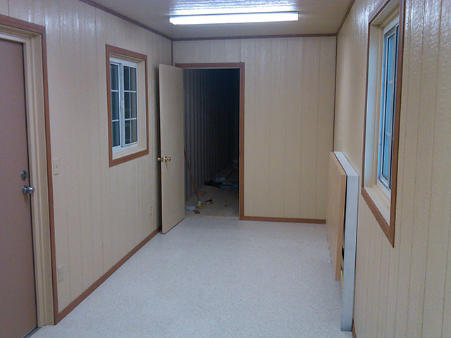Inside view of a Best Value mobile office container with finished walls and doors